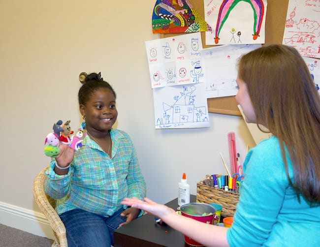 Therapist and child in play therapy session